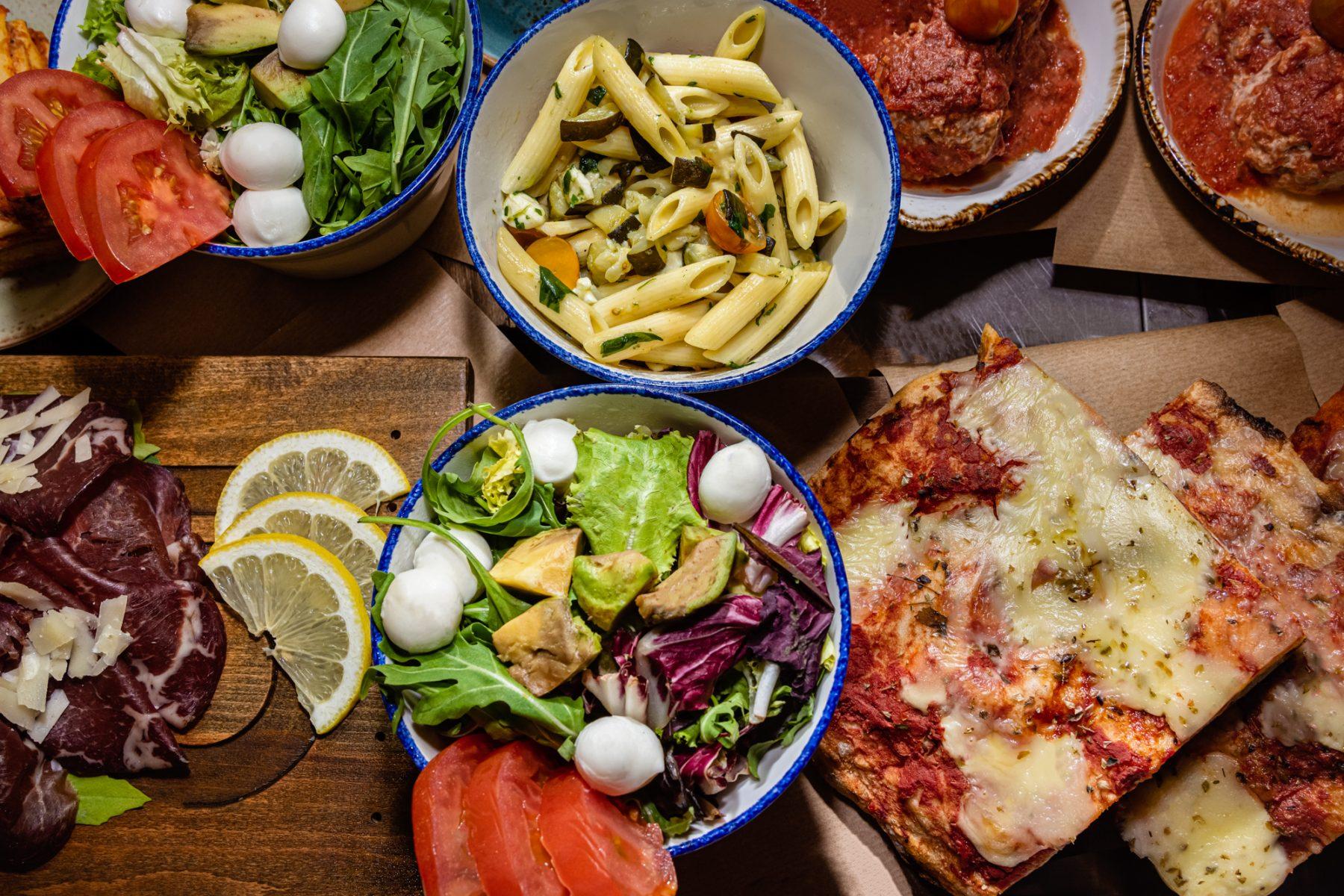 cinc food parlour food display pasta lasagne pizza salad